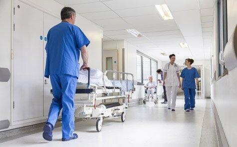 Nurse pushing hospital bed
